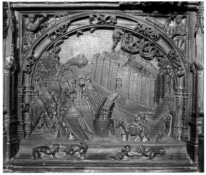 Figura 1. Tablero de la sillería del coro bajo de la Catedral de Toledo (1494-1495) donde aparecen los Reales de la Vega (izquierda) y de Santa Fe (derecha) con la ciudad de Granada en último término. Fernández Aparicio (2006)