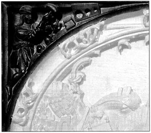 Figura 2. Detalle de la enjuta izquierda del tablero de la sillería del coro bajo de la Catedral de Toledo en el que se representó Santa Fe. García Pulido y col. (2004)