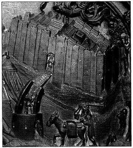 Figura 2. Detalle del Real de Santa Fe en el tablero de la sillería del coro bajo de la Catedral de Toledo en el que se representan las murallas almenadas, las torres, las cavas y una puerta de entrada con su baluarte, su través y su puente levadizo. García Pulido y col. (2005)